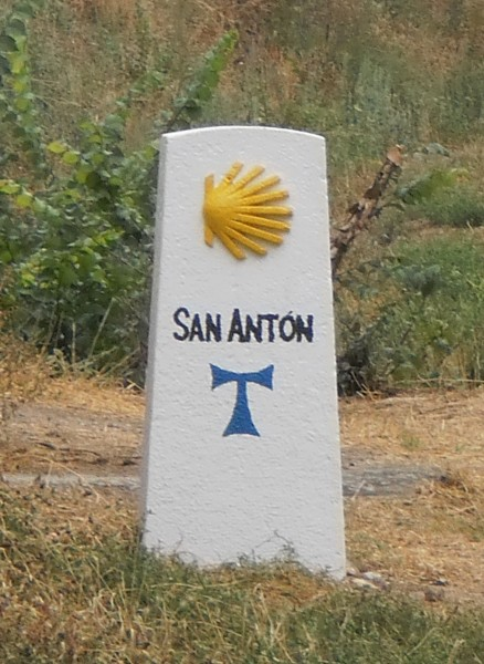 Camino way marker with San Anton cross